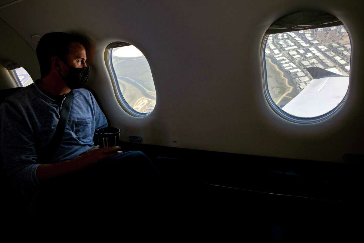 A SurfAir passenger looks out at the bay after takeoff at the regional airport in San Carlos.
