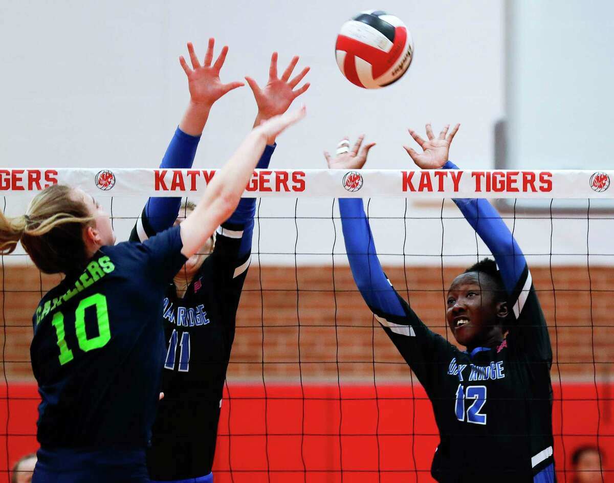 Oak Ridge's Samiah Howard (12) and Frankye Granack (11) pressure a shot by College Park's Cassidy Copeland (10) during a match in the Katy/Cy-Fair Tournament at Katy High School, Friday, Aug. 13, 2021, in Katy.