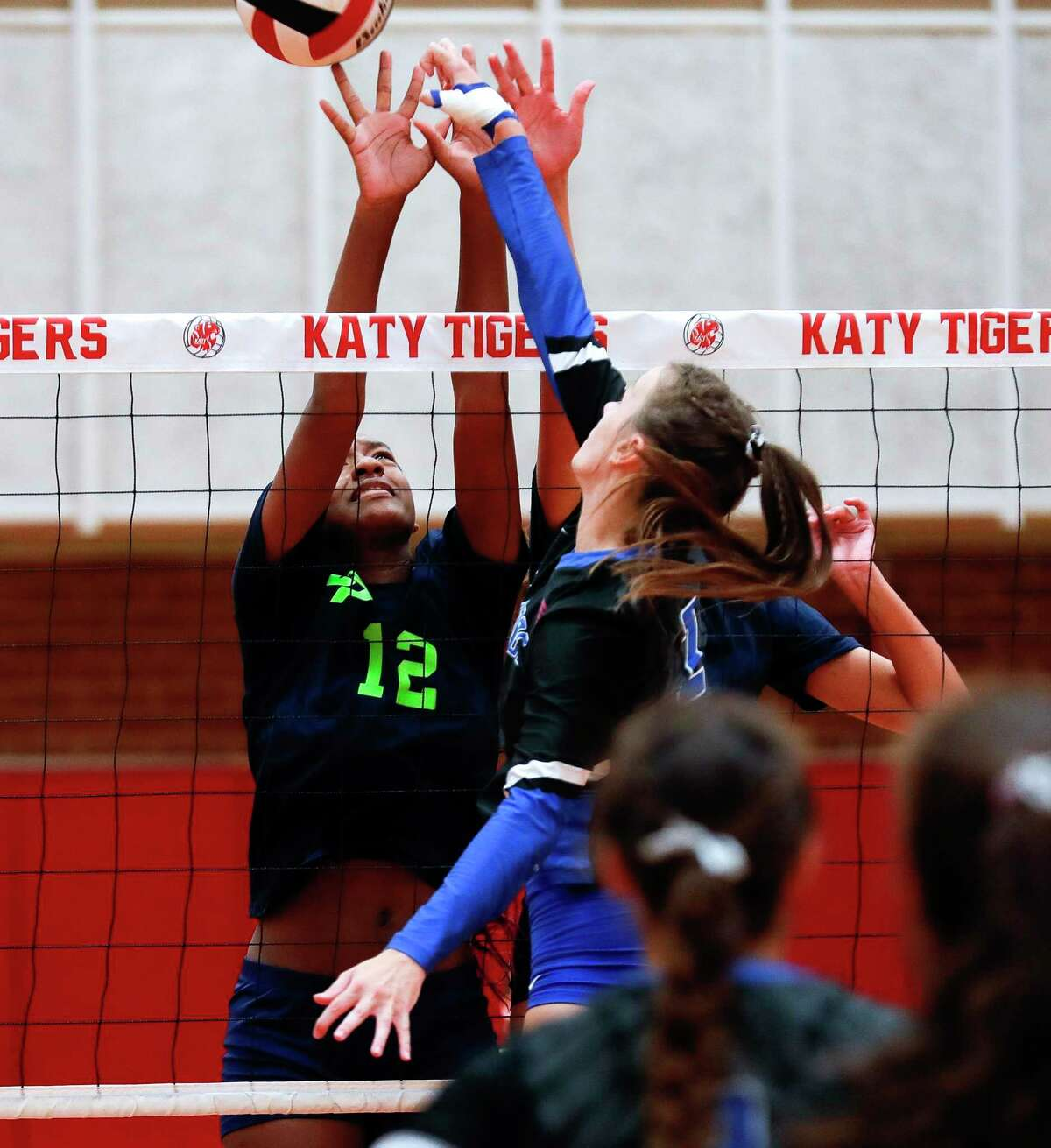College Park's Don Yah Cosie (12) blocks the hit by Oak Ridge's Sofia Richmond (4) during a match in the Katy/Cy-Fair Tournament at Katy High School, Friday, Aug. 13, 2021, in Katy.