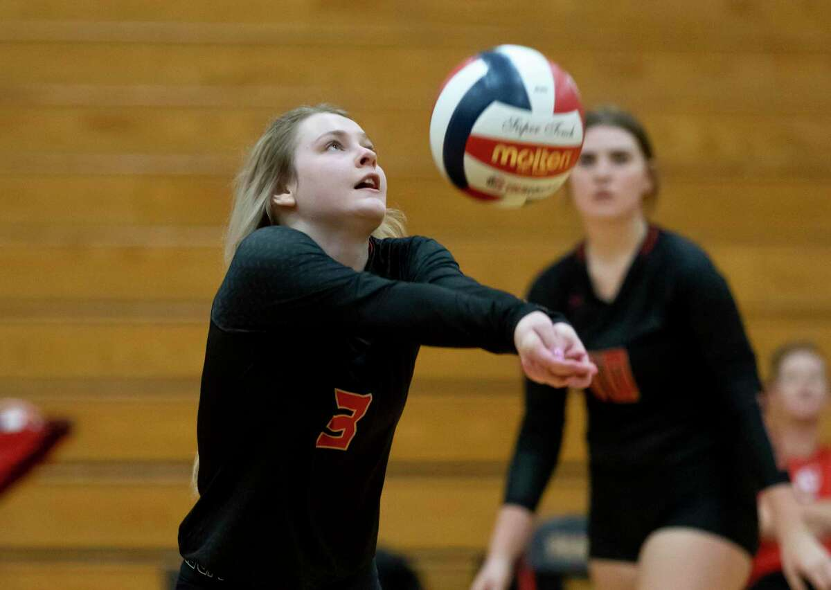 Caney Creek Laela Cole (3) returns the ball during the second set of a non-district volleyball match against Huntsville at Caney Creek High School, Friday, Aug. 13, 2021, in Conroe.