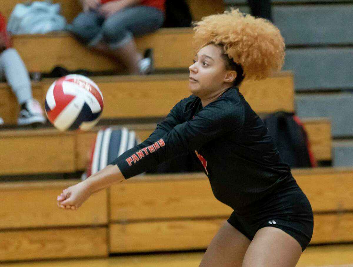 Caney Creek Elauhn Parrish (13) returns a serve during the third set of a non-district volleyball match against Huntsville at Caney Creek High School, Friday, Aug. 13, 2021, in Conroe.