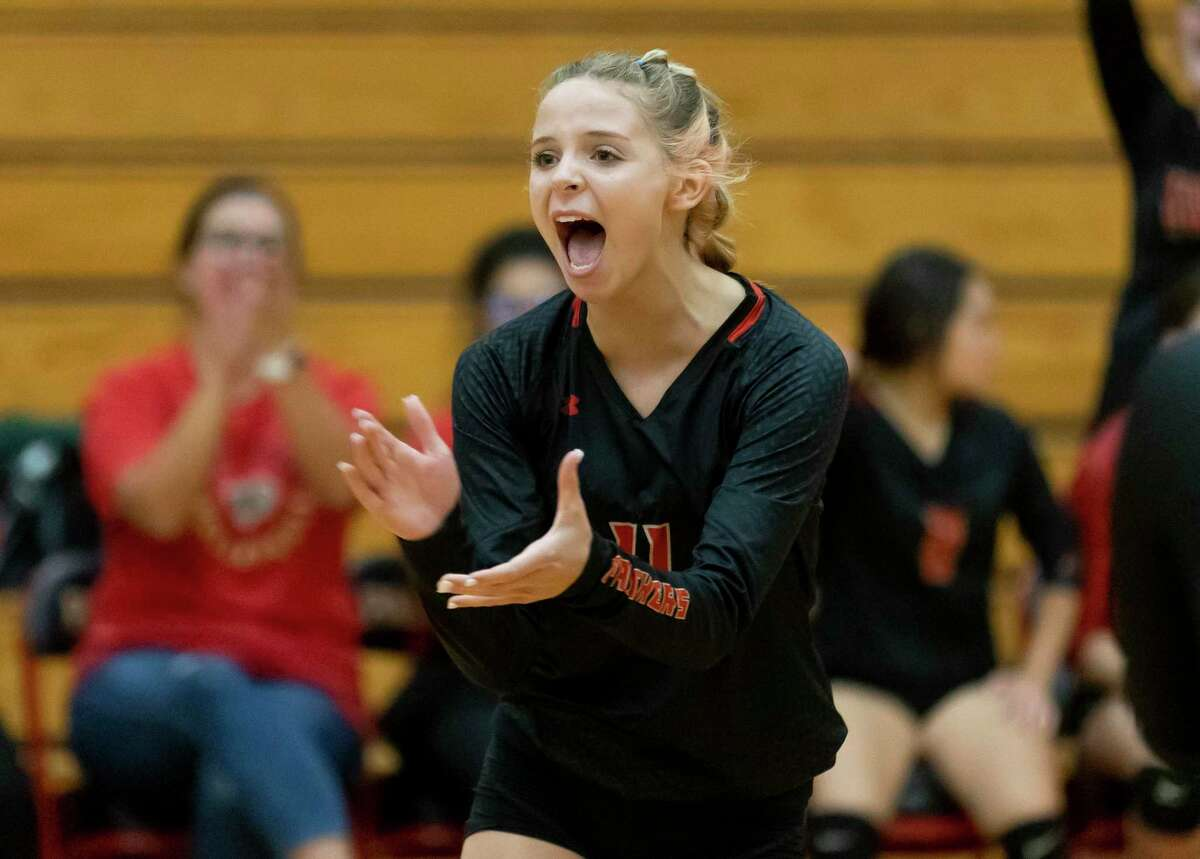Caney Creek Emily Bockelman (11) reacts after her team scores during the second set of a non-district volleyball match against Huntsville at Caney Creek High School, Friday, Aug. 13, 2021, in Conroe.