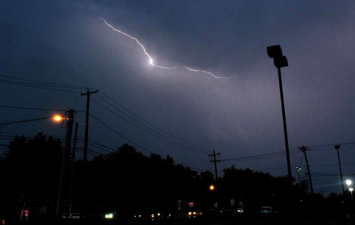 Lightning illuminates the sky over Western Ave. on Friday, Aug. 13, 2021 in Guilderland, N.Y. A thunderstorm with heavy rains passed through the Capital District.