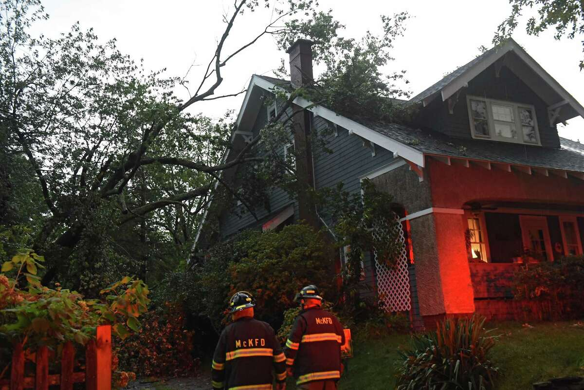 A tree fell on a house on Waverly Place on Friday, Aug. 13, 2021 in Guilderland, N.Y. A thunderstorm with heavy rains passed through the Capital District.