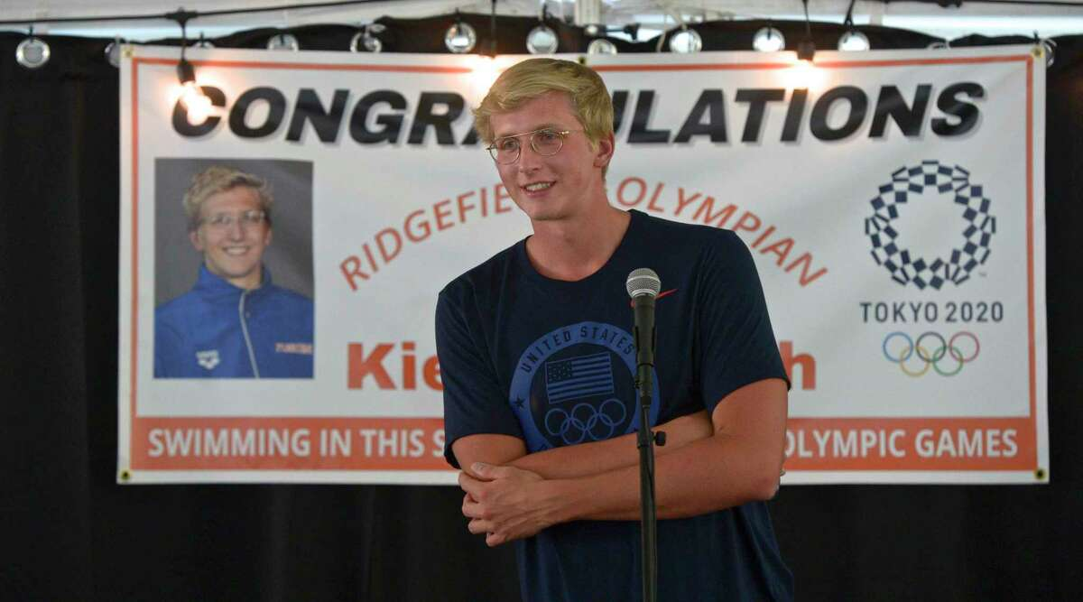 Olympian Kieran Smith, of Ridgefield, listens to a question at a event organized by the Ridgefield Aquatic Club on Friday afternoon.