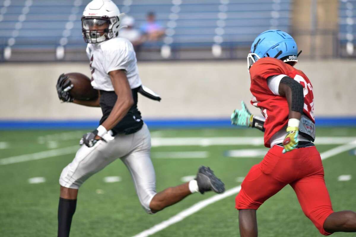Legacy's Chris Brazzell runs to score a touchdown as Monterey's Andrae Moore runs after him Friday, Aug. 13, 2021 at Grande Communications Stadium. Jacy Lewis/Reporter-Telegram