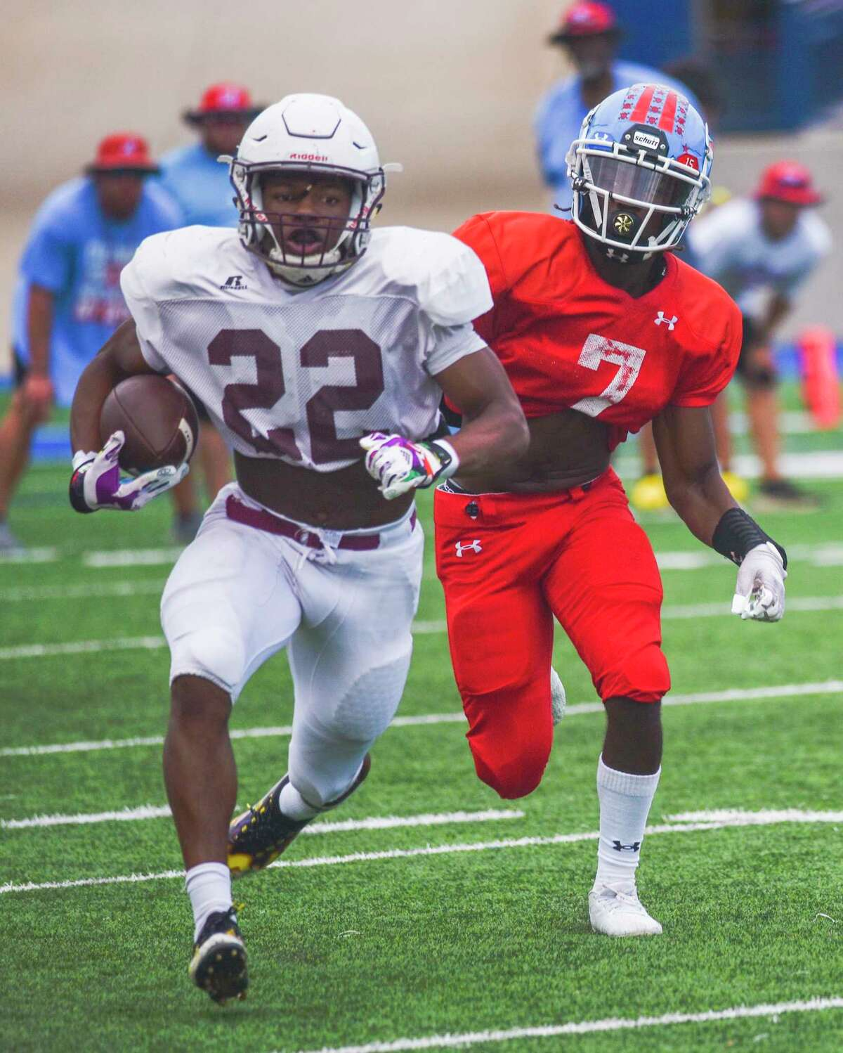 Legacy's Makhilyn Young (22) carries the ball as Monterey's KyShon Harris (7) trails him Friday, Aug. 13, 2021 at Grande Communications Stadium. Jacy Lewis/Reporter-Telegram
