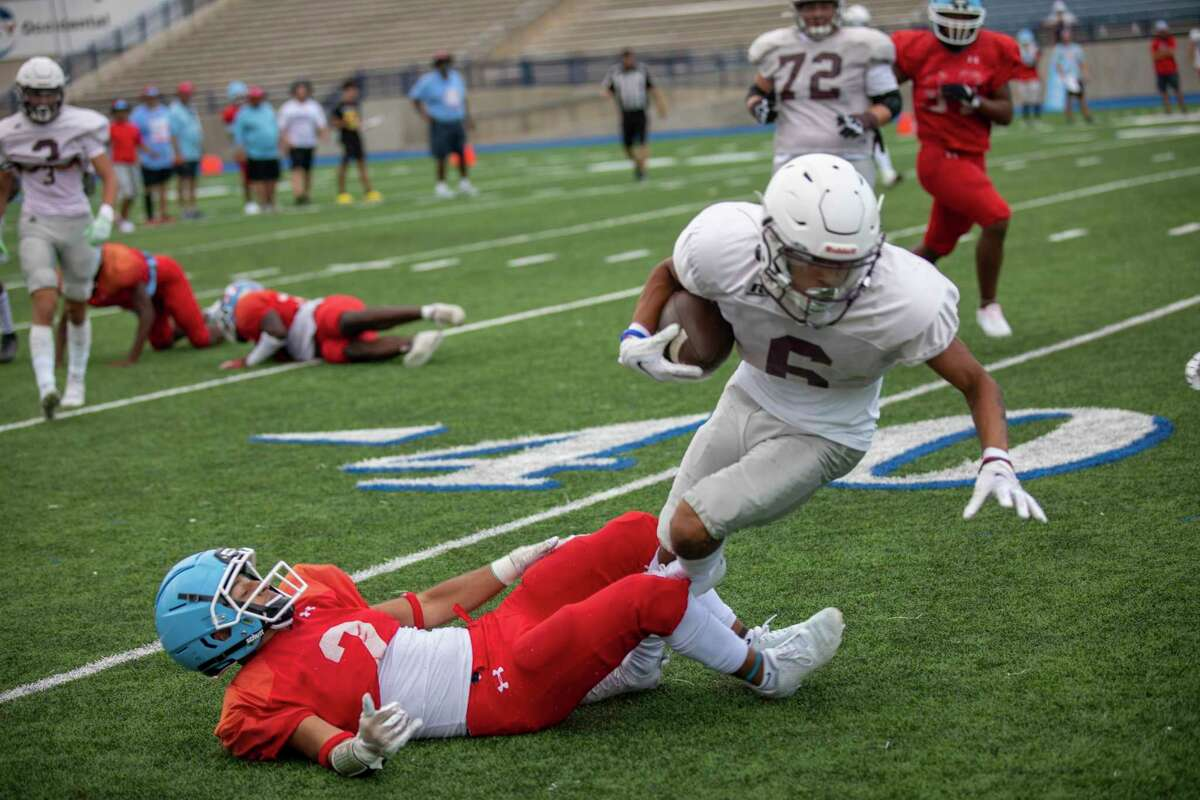 Legacy's Michael Valles (6) is tripped up by Monterey's MJ Singleton on Friday, Aug. 13, 2021 at Grande Communications Stadium. Jacy Lewis/Reporter-Telegram
