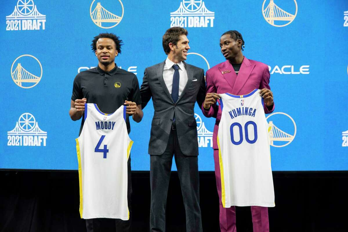 From left: Moses Moody, Golden State Warriors general manager Bob Myers and Jonathan Kuminga at Chase Center, Friday, July 30, 2021, in San Francisco, Calif. The Golden State Warriors selected Kuminga (No. 7) and Moody (No. 14) in the NBA Draft on Thursday night.