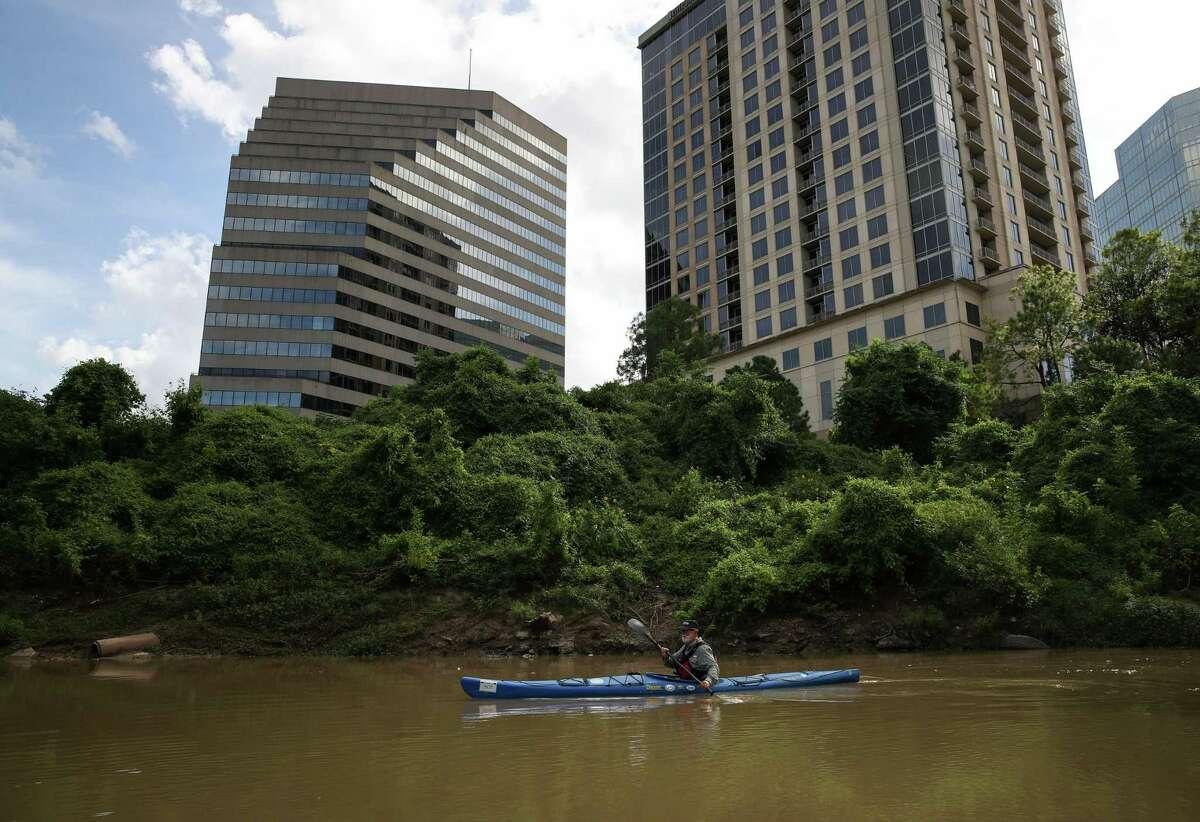 Bruce Bodson kayaks Sunday, Aug. 8, 2021, in Buffalo Bayou in Houston.