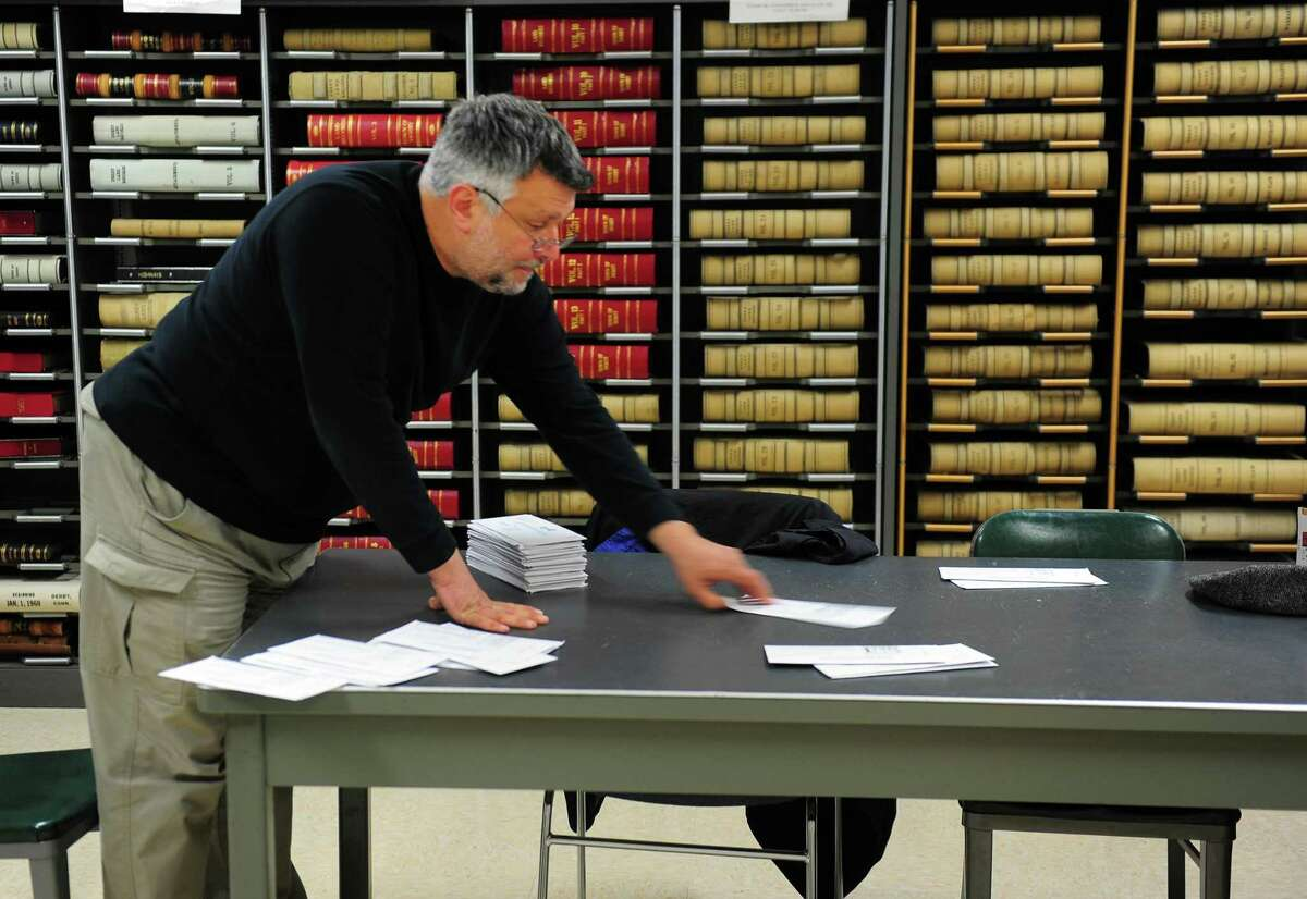 Derby Town Clerk Marc Garofalo sorted through hundreds of absentee ballots at Derby City Hall last year.
