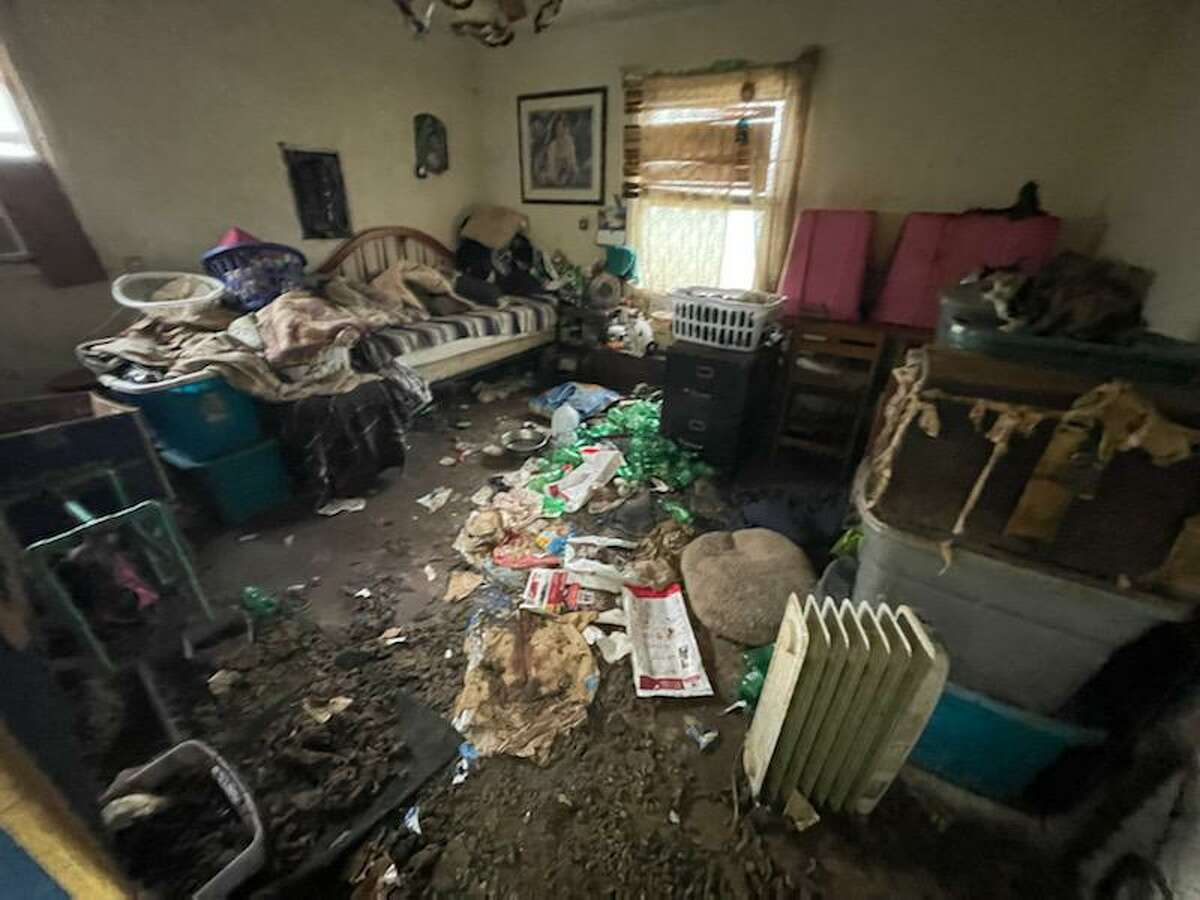 """Photos taken from inside a Porter home around Aug. 4 show what officials are calling """"deplorable conditions"""" where scores of animals lived and died. Some of those conditions included animal feces and dead pets in a freezer. The surviving animals were seized by the Montgomery County Animal Taskforce."""