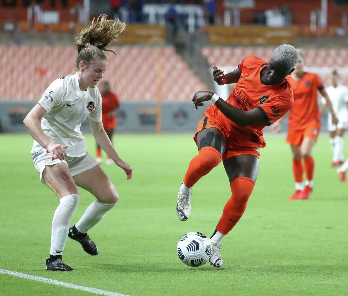 Houston Dash Michaela Abam (34) battles against Washington Spirit midfielder Anna Heilferty (21) during the second half of a National Women's Soccer League game at BBVA Stadium, Friday, August 13, 2021, in Houston. Final score was 2-2. .