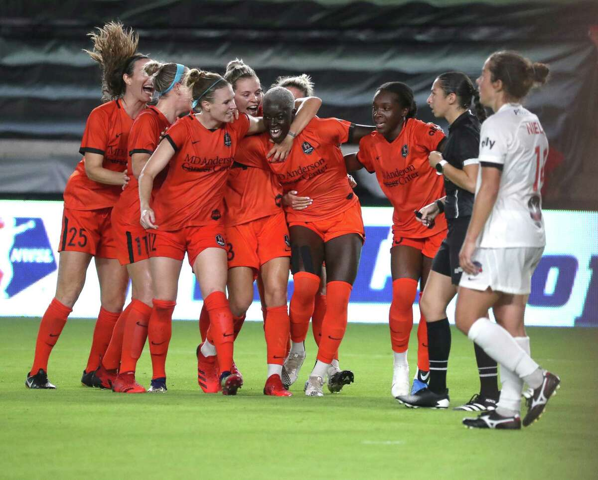 Houston Dash Michaela Abam (34) is surrounded by teammates after she scored a goal during the second half of a National Women's Soccer League game at BBVA Stadium, Friday, August 13, 2021, in Houston. Final score was 2-2. .