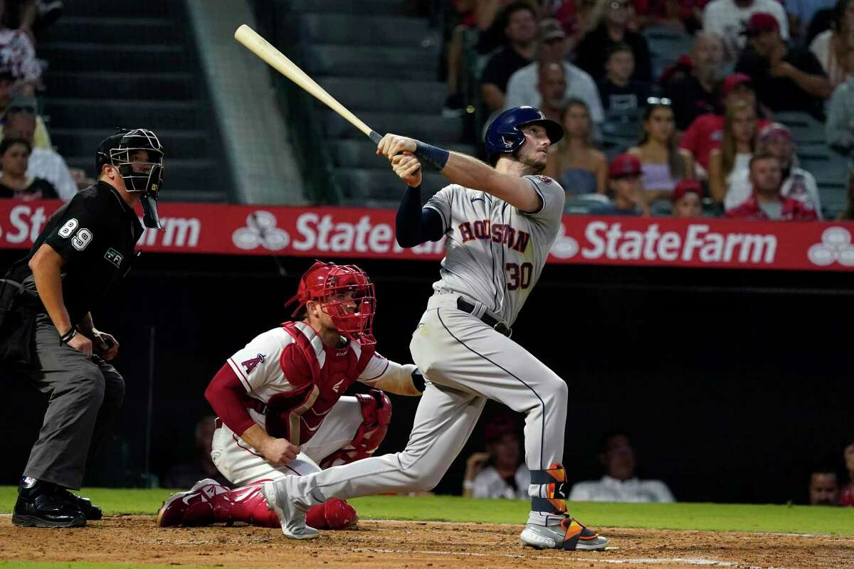 Houston Astros' Kyle Tucker watches his grand slam during the fourth inning of the team's baseball game against the Los Angeles Angels on Friday, Aug. 13, 2021, in Anaheim, Calif. (AP Photo/Marcio Jose Sanchez)