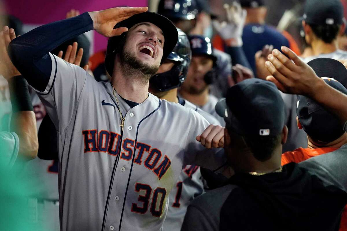 Houston Astros' Kyle Tucker (30) celebrates in the dugout after his grand slam during the fourth inning of the team's baseball game against the Los Angeles Angels on Friday, Aug. 13, 2021, in Anaheim, Calif. (AP Photo/Marcio Jose Sanchez)