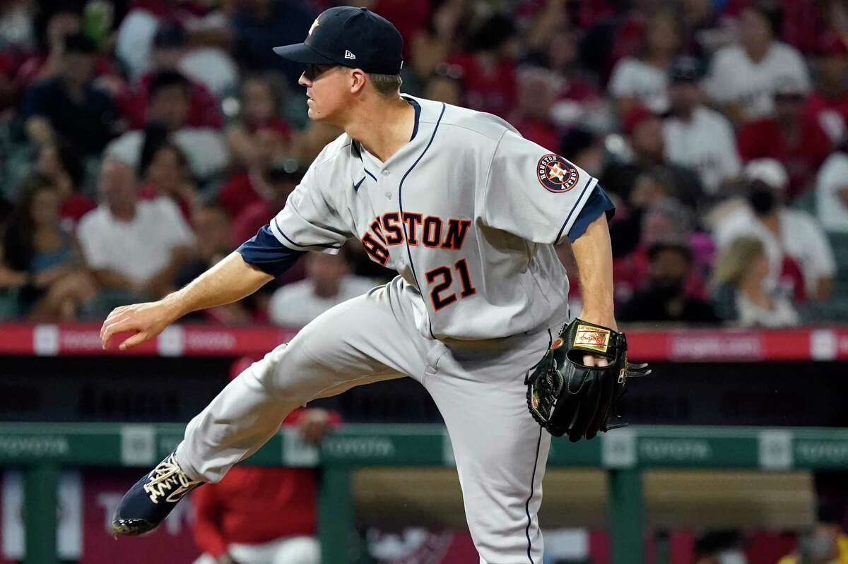 Houston Astros starting pitcher Zack Greinke watches a throw to a Los Angeles Angels batter during the fifth inning of a baseball game Friday, Aug. 13, 2021, in Anaheim, Calif. (AP Photo/Marcio Jose Sanchez)