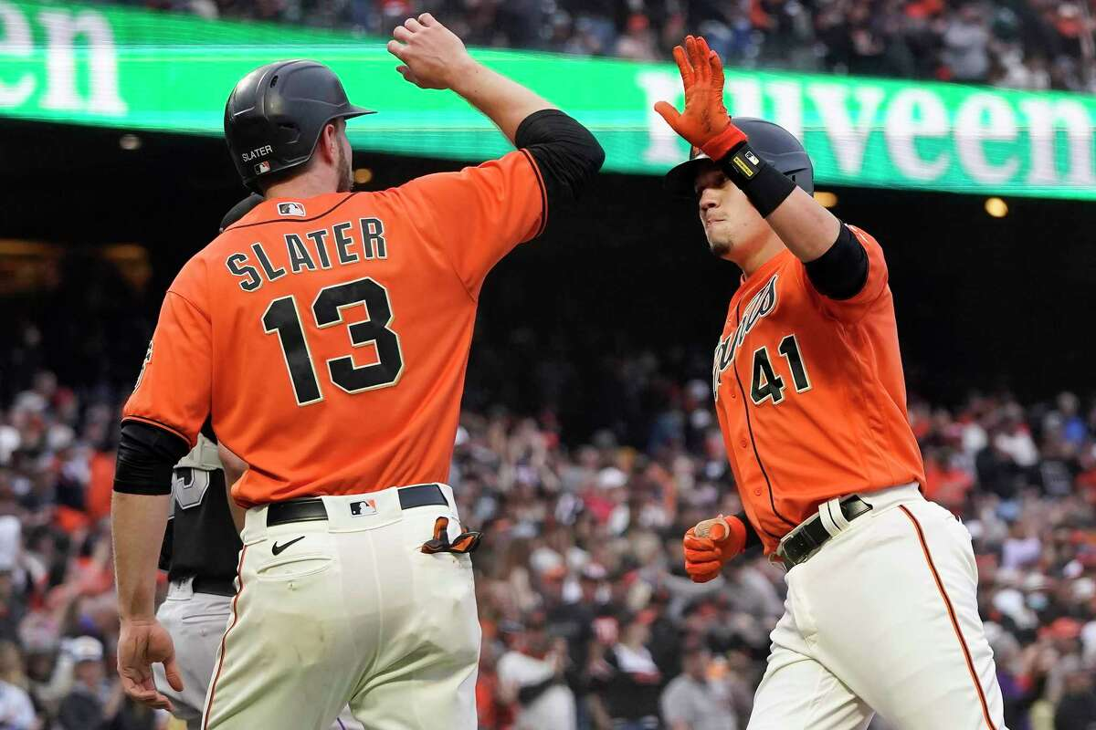 San Francisco Giants' Wilmer Flores (41) celebrates after hitting a three-run home run that also scored Austin Slater (13) during the first inning of after a baseball game in San Francisco, Friday, Aug. 13, 2021. (AP Photo/Jeff Chiu)