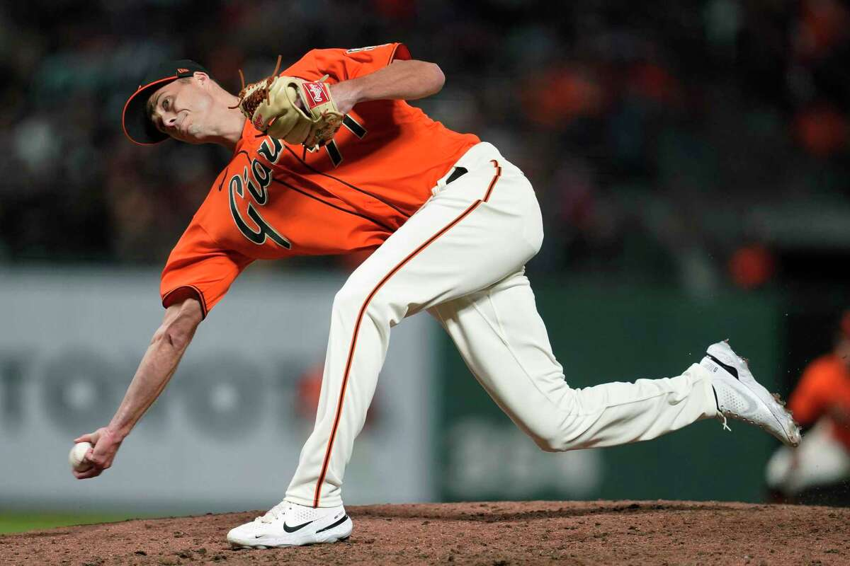San Francisco Giants' Tyler Rogers pitches against the Colorado Rockies during the eighth inning of a baseball game in San Francisco, Friday, Aug. 13, 2021. (AP Photo/Jeff Chiu)