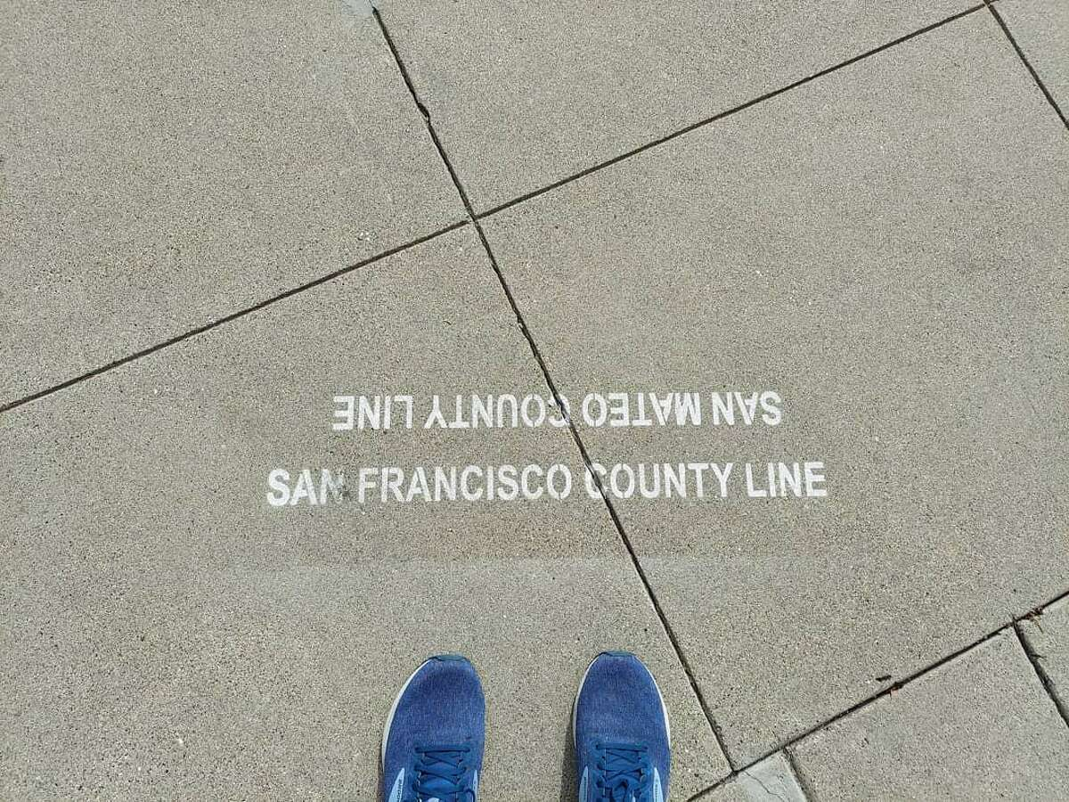 The author's toes at the San Francisco/San Mateo County line.