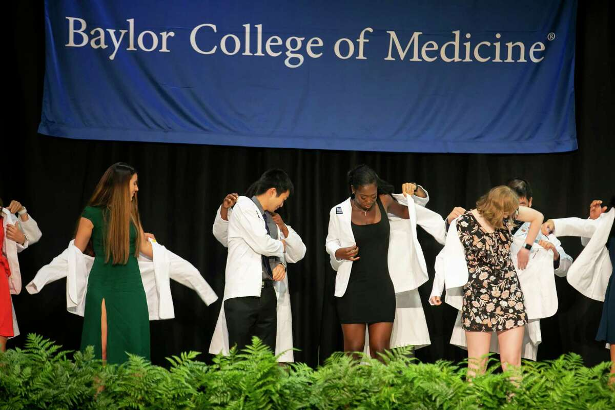 Baylor College of Medicine students receive their white coats in a ceremony at the Bayou City Event Center on Friday, Aug. 13, 2021.