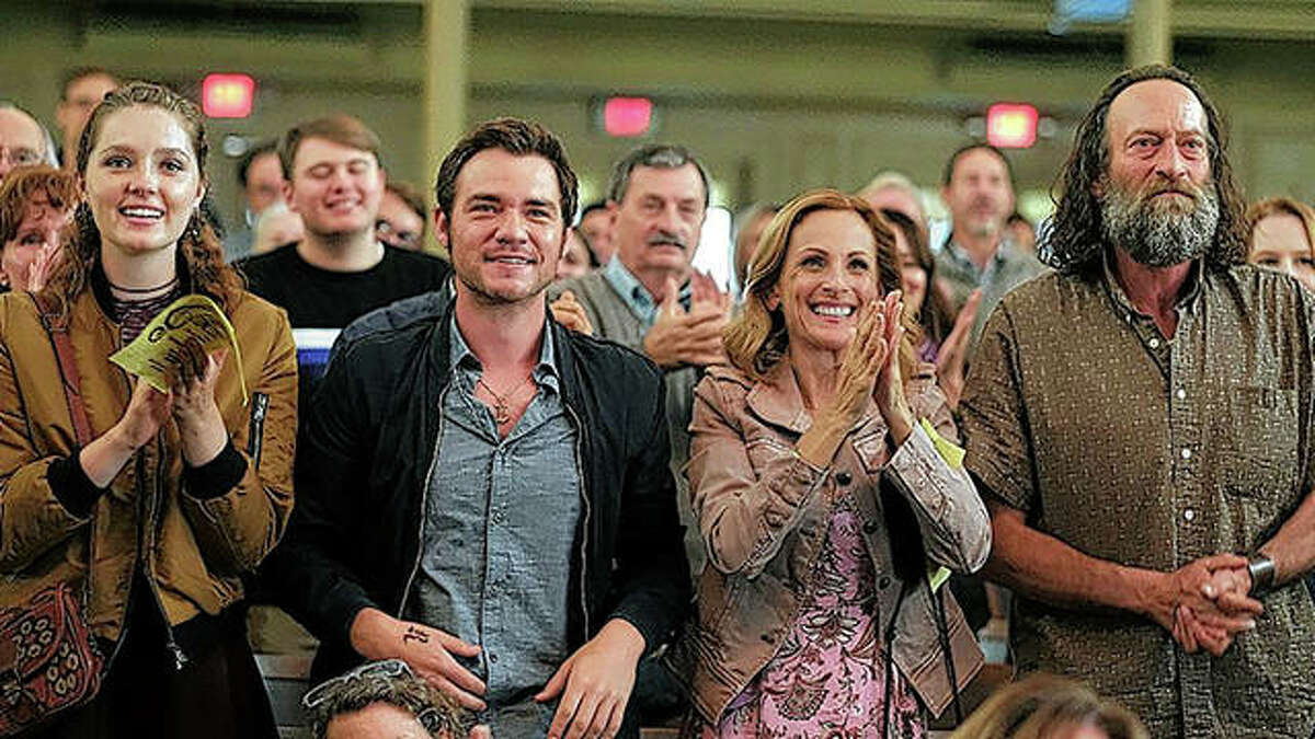 """Amy Forsyth (from left), Daniel Durant, Marlee Matlin and Troy Kotsur share a scene in """"CODA."""""""