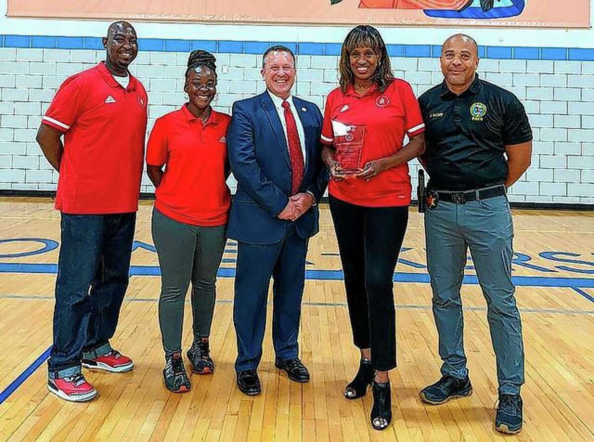 Jackie Joyner-Kersee (second from right) and representatives (left) of the Jackie Joyner-Kersee Foundation in East St. Louis accept the Springfield division of the Federal Bureau of Investigation's Director's Community Leadership Award for 2020.