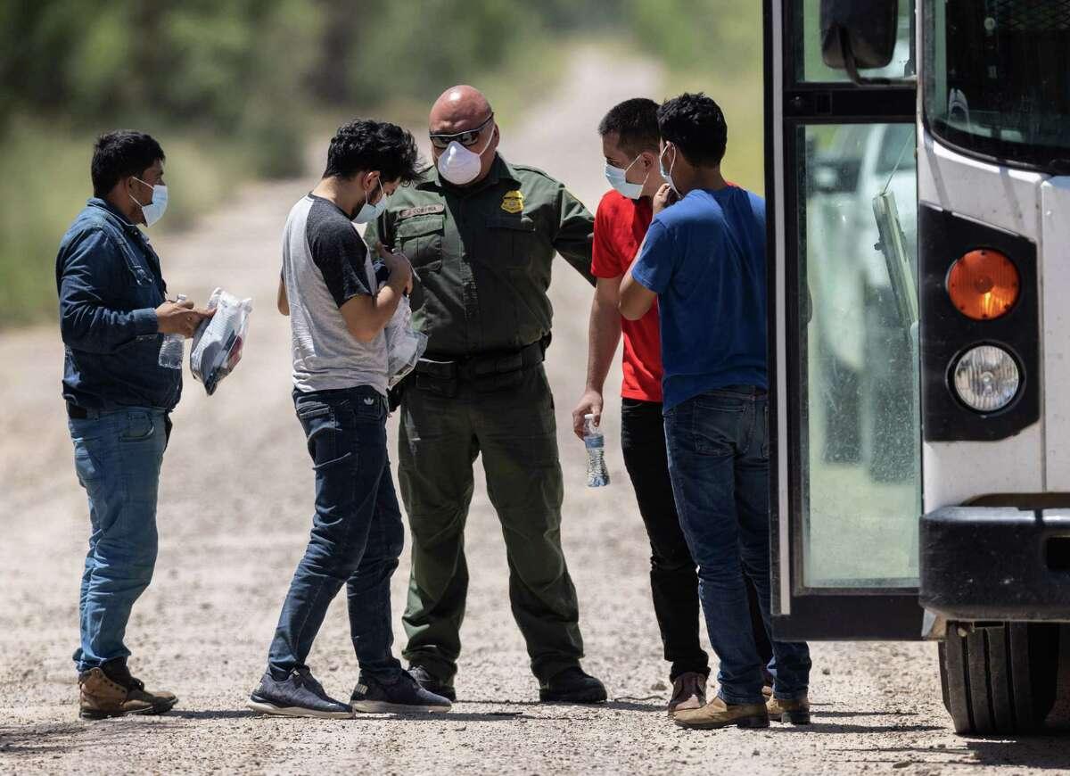 A U.S. Border Patrol agent instructs unaccompanied teenagers in La Joya before they're sent to a facility.