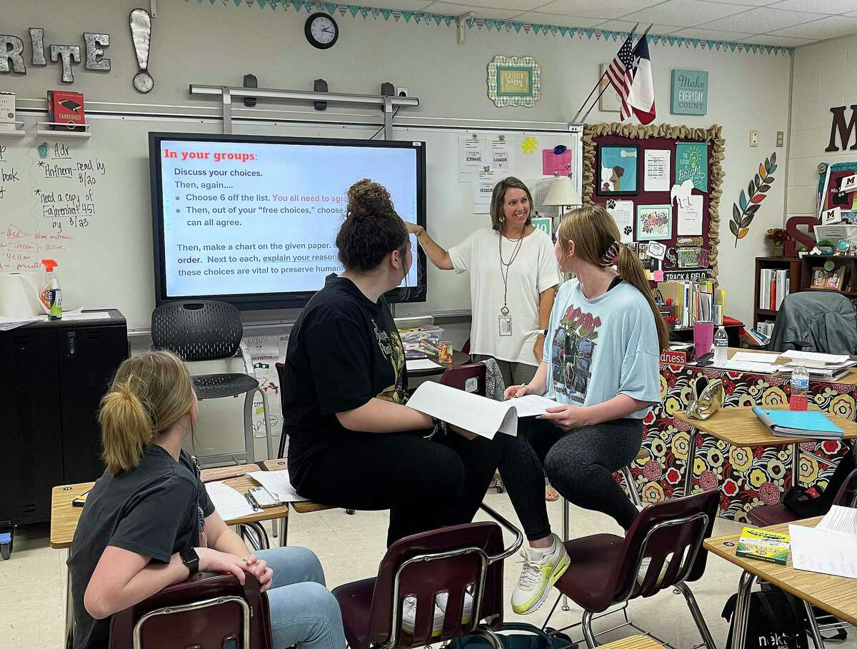 Kristen Saldana stands next to her smart board going over a classroom assignment for her students at Magnolia High School. The 22-year veteran instructor said there is less stress this year compared to 2020.