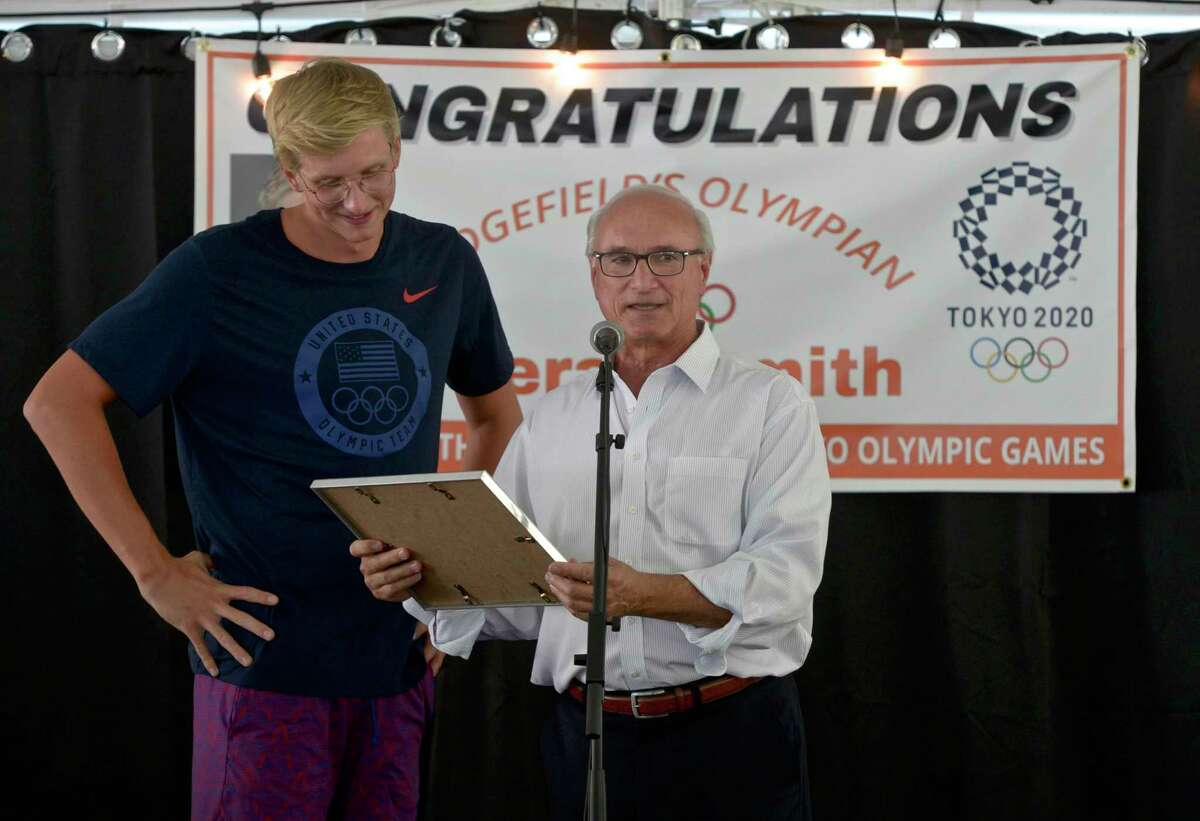 Ridgefield First Selectman Rudi Marconi, right, presented Olympian Kieran Smith, of Ridgefield, with a proclamation at a event organized by the Ridgefield Aquatic Club on Friday afternoon. August 13, 2021, Ridgefield, Conn. Smith won a bronze medal in the 400-meter freestyle in the Tokyo Olympics.
