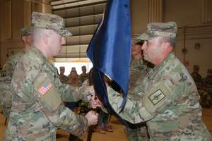 Maj. Doug Berinstein, left, accepts the unit flag of the Joint Force Headquarters Detachment from Maj. Gen. Michel Natali, assistant adjutant of the New York Army National Guard.(Major Jean-Marie Kratzer / New York Army National Guard)