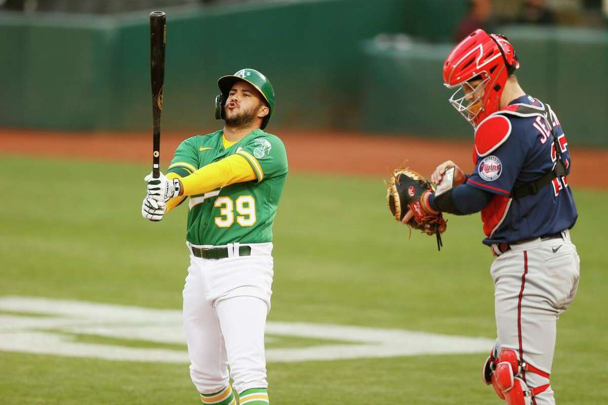 Oakland Athletics second baseman Vimael Machin (39) at bat in the second inning during the second game of an MLB doubleheader against the Minnesota Twins at RingCentral Coliseum on Tuesday, April 20, 2021, in Oakland, Calif.