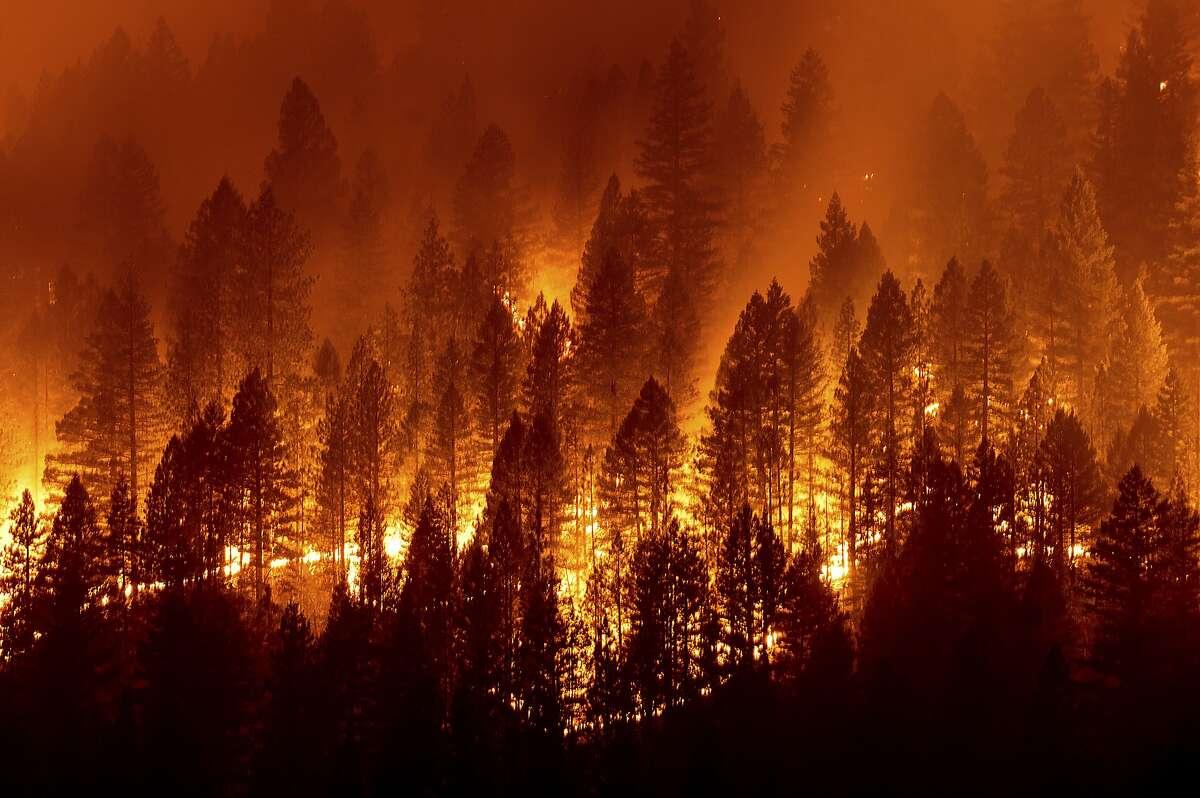 The Dixie Fire burns down a hillside toward Diamond Mountain Road near Taylorsville (Plumas County) on Friday.