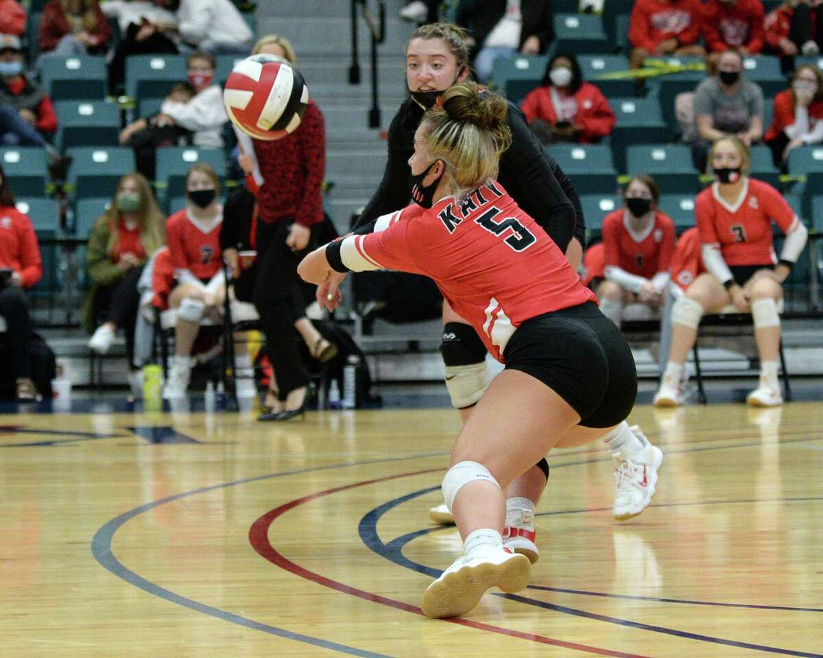 Izzy Denton (5) of Katy digs a ball during the fourth set of the 6A Region 3 Championship game between the Katy Tigers and the Seven Lakes Spartans on Friday, December 4, 2020 at Leonard Merrell Center, Katy, TX.
