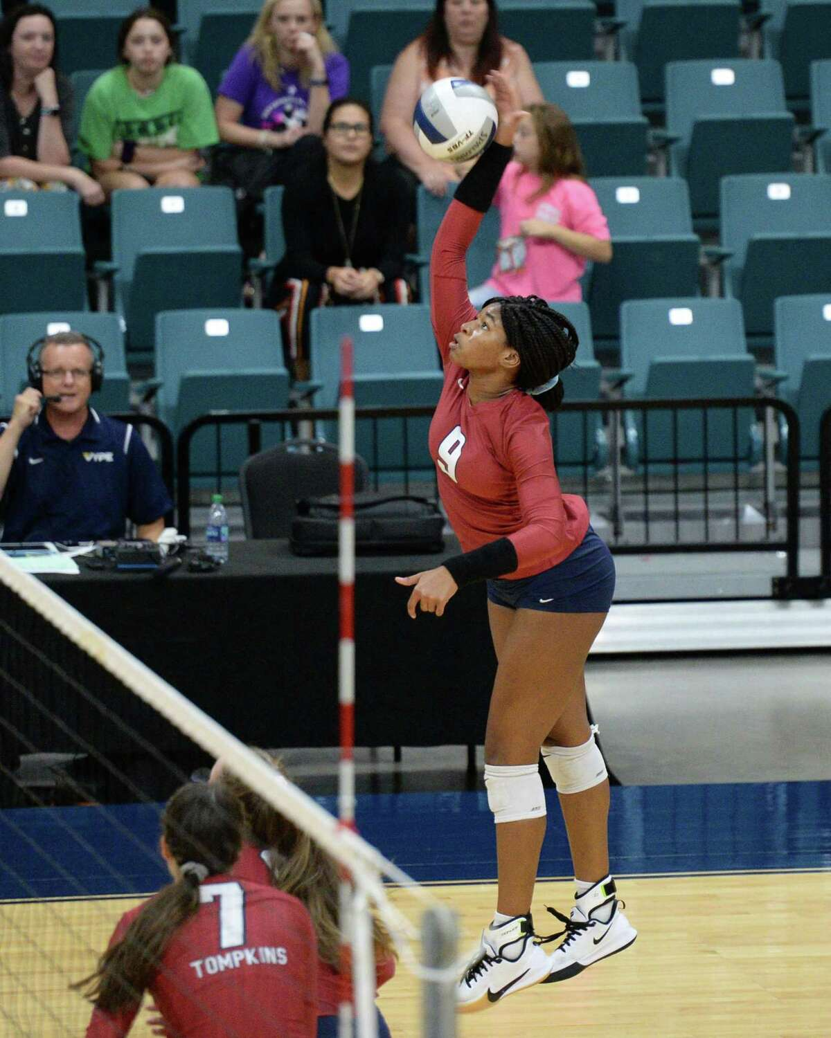 Tendai Titley (9) of Tompkins hits a shot during the second set of a Class 6A Region III bi-district volleyball playoff match between the Tompkins Falcons and the Ridge Point Panthers on Tuesday, November 5, 2019 at the Leonard Merrell Center, Katy, TX.