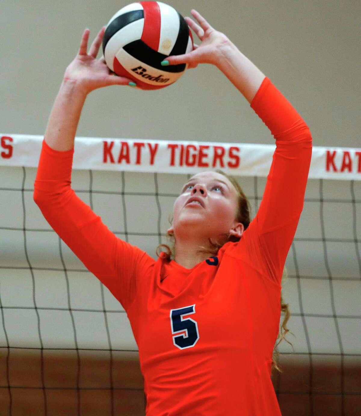 Seven Lakes' Casey Batenhorst (5) sets the ball during a match in the Katy/Cy-Fair Tournament at Katy High School, Friday, Aug. 13, 2021, in Katy.