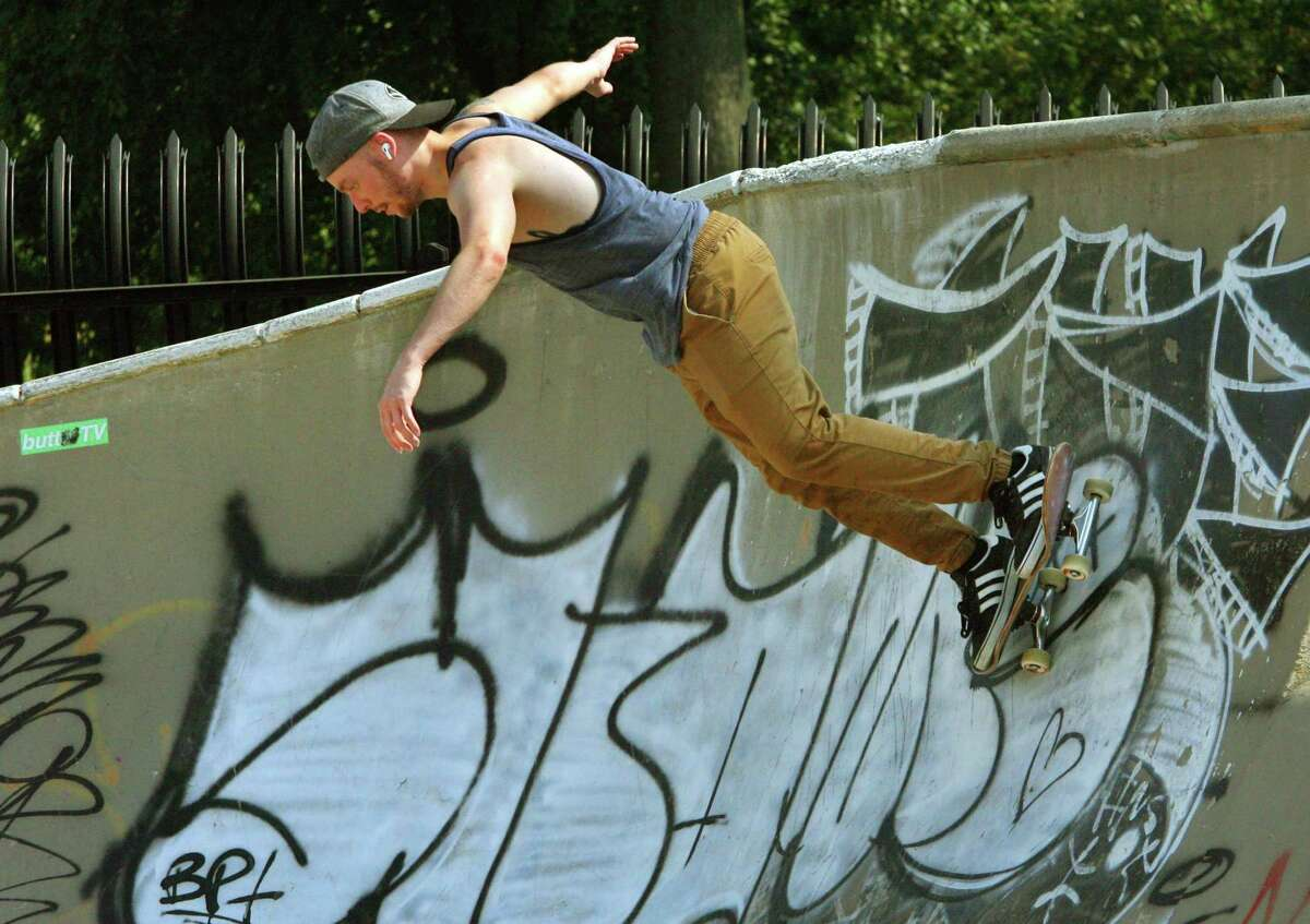 Sean Lewis skateboards in a bowl at the skateboarding park in Scalzi Park in Stamford, Conn., on Saturday August 6, 2021.