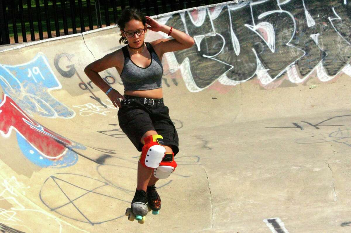 A girl rollerskates in a bowl at the skateboarding park in Scalzi Park in Stamford, Conn., on Saturday August 6, 2021.