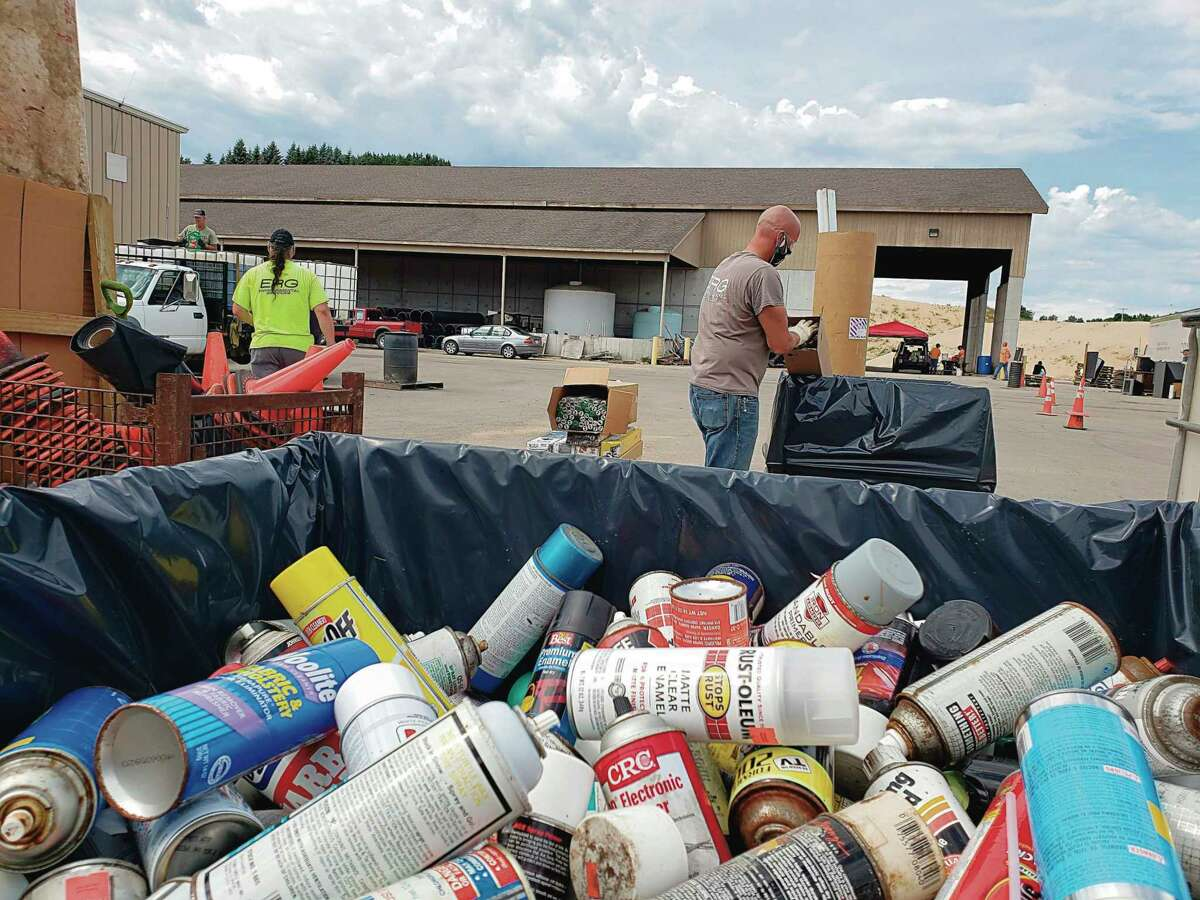 In 2020, residents lined up and volunteers unloaded materials from the vehicles into separate areas of the site depending on the type of material during the drive-thru hazardous materials collection event at the Manistee County Road Commission. This year's event is slated for Aug. 21. (File photo)