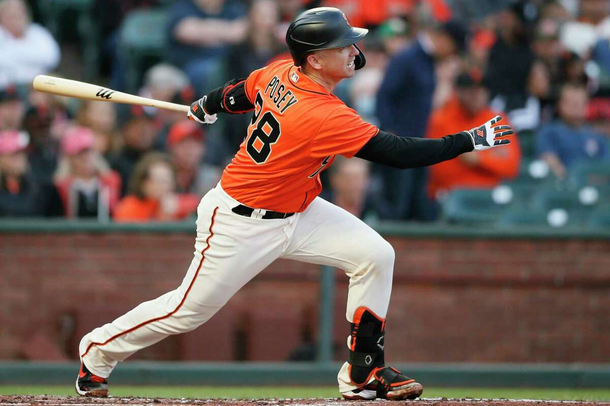 San Francisco Giants catcher Buster Posey (28) lines out to Houston Astros shortstop Carlos Correa (1) in the first inning during an MLB game at Oracle Park, Friday, July 30, 2021, in San Francisco, Calif.