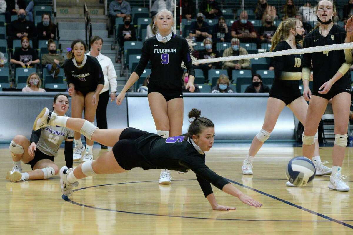 Ava Underwood (6) of Fulshear dives for a ball during the third set of the Class 5A state semifinal volleyball match between the Fulshear Chargers and the Dripping Springs Tigers on Tuesday, December 8, 2020 at Leonard Merrell Center, Katy, TX.