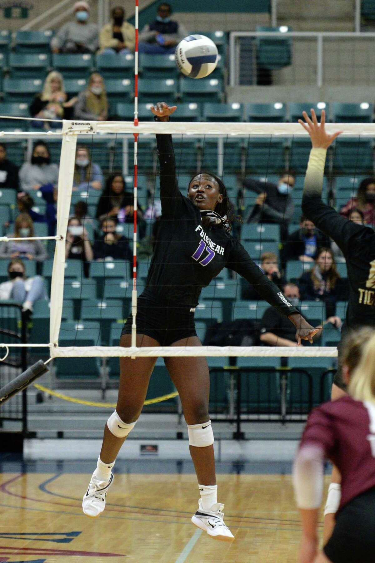 Brielle Warren (17) of Fulshear spikes a ball during the third set of the Class 5A state semifinal volleyball match between the Fulshear Chargers and the Dripping Springs Tigers on Tuesday, December 8, 2020 at Leonard Merrell Center, Katy, TX.