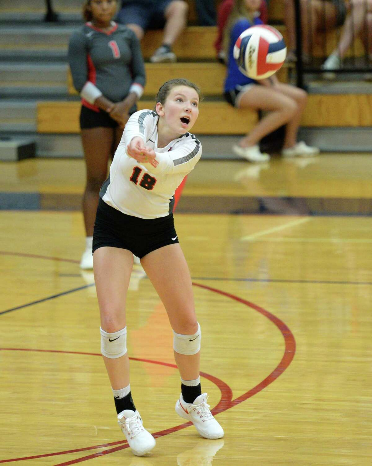 Kynzie Lilly (18) of Travis digs for a ball during the third set of a volleyball match between the Tompkins Falcons and the Travis Tigers on Tuesday, August 6, 2019 at the Travis HS, Katy, TX.