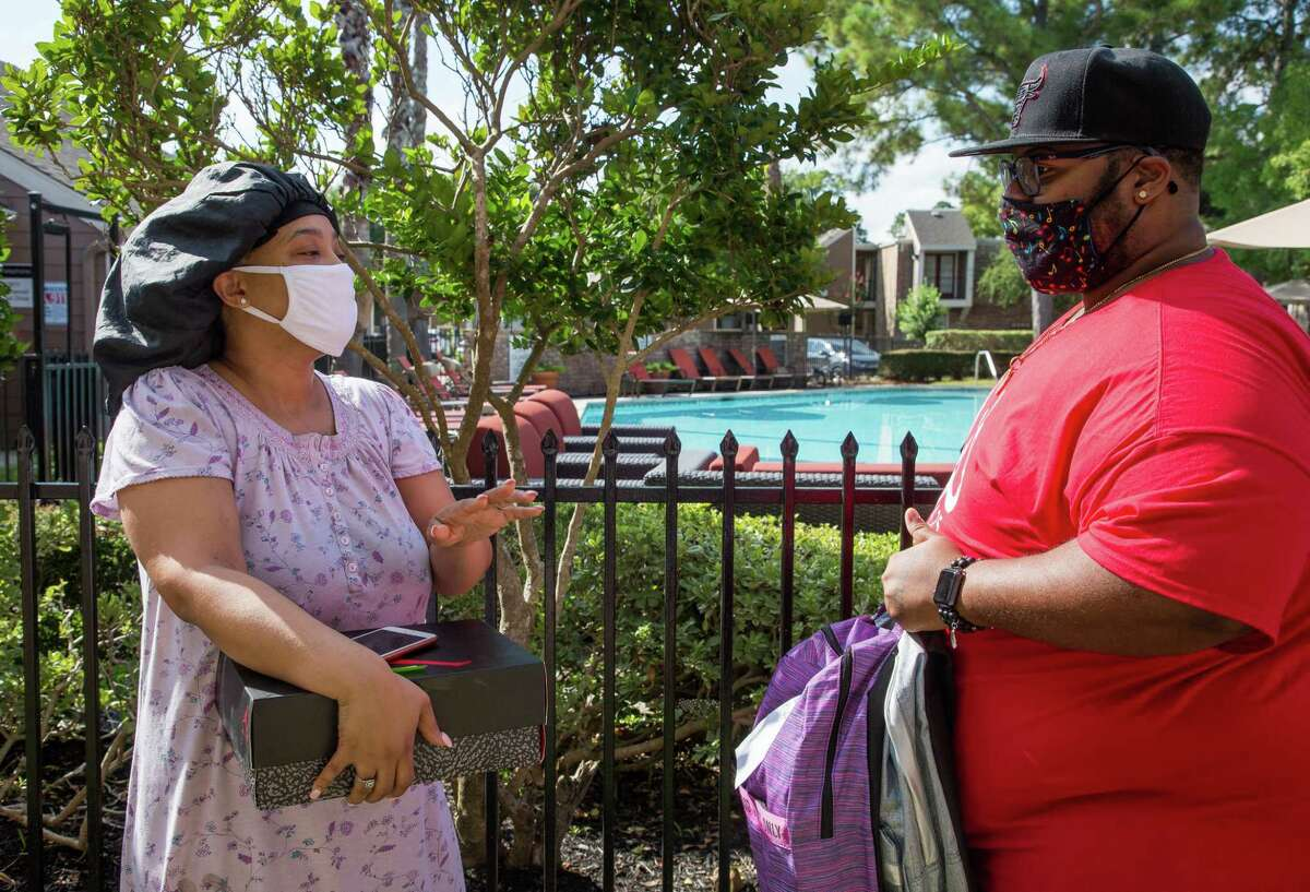 Jermaine Williams delivered two backpacks and a pair of Jordan sneakers to Kerilynn Grundy - who has five children - on Saturday, Aug. 14, 2021, in Houston. Williams and his wife Chandress raised money to buy backpacks and school supplies for 40 students.