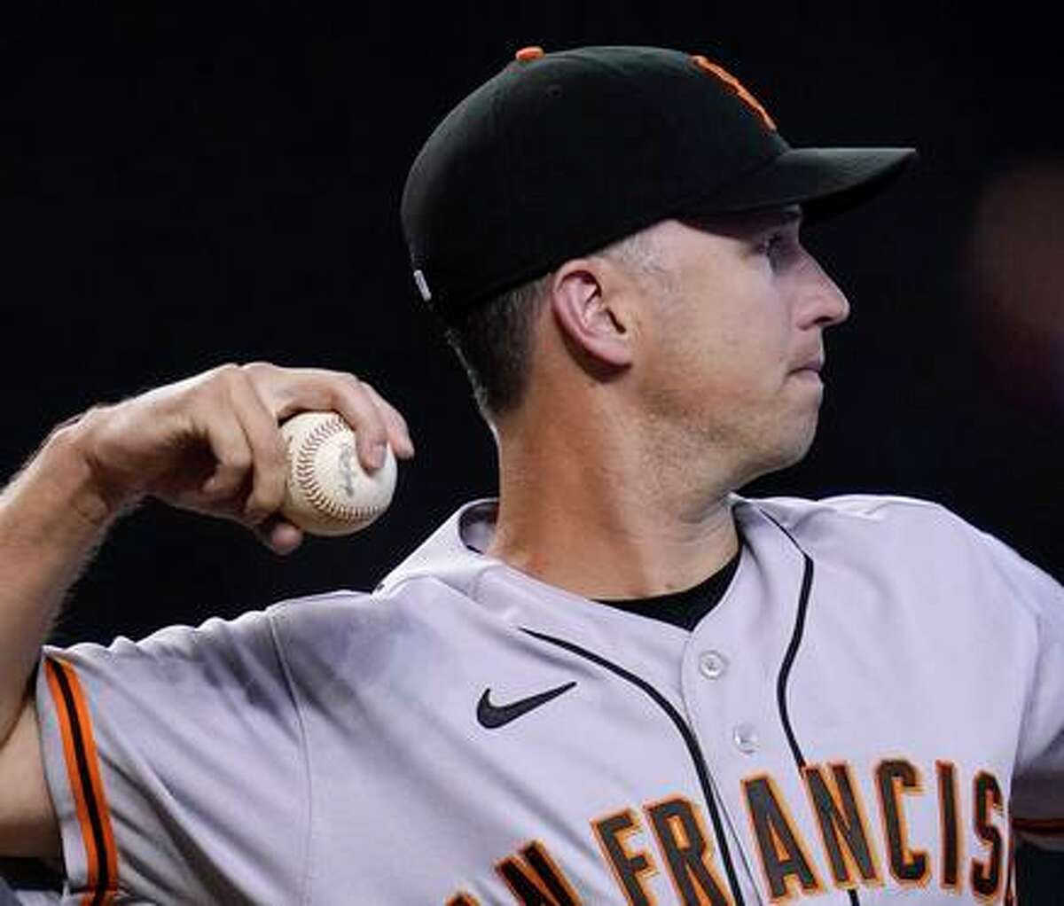 San Francisco Giants catcher Buster Posey throws the ball back to the pitcher during the seventh inning of a baseball game against the Arizona Diamondbacks, Thursday, Aug. 5, 2021, in Phoenix. The Giants defeated the Diamondbacks 5-4. (AP Photo/Ross D. Franklin)