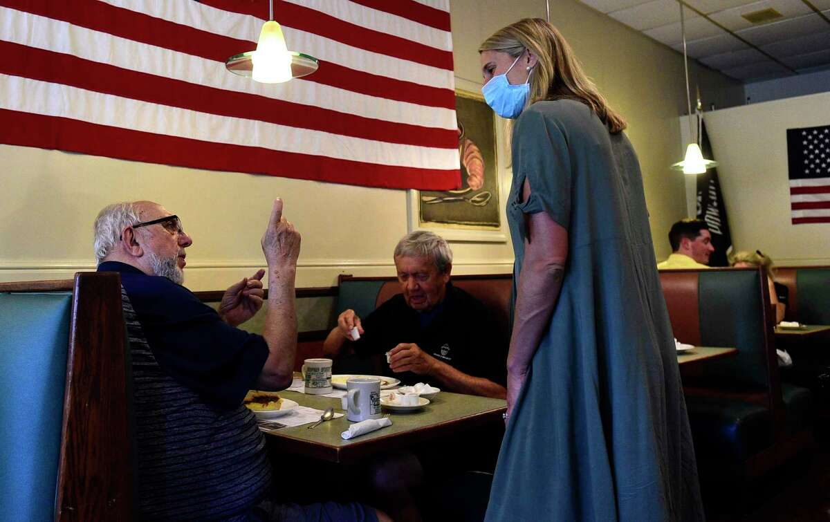 Customers, including Stamford residents Joe Denicola and Monsignor Surwilo, chat with State Rep. Caroline Simmons who was endorsed by the Democratic City Committee campaigns for mayor Saturday morning at Bedford Street Diner in Stamford.