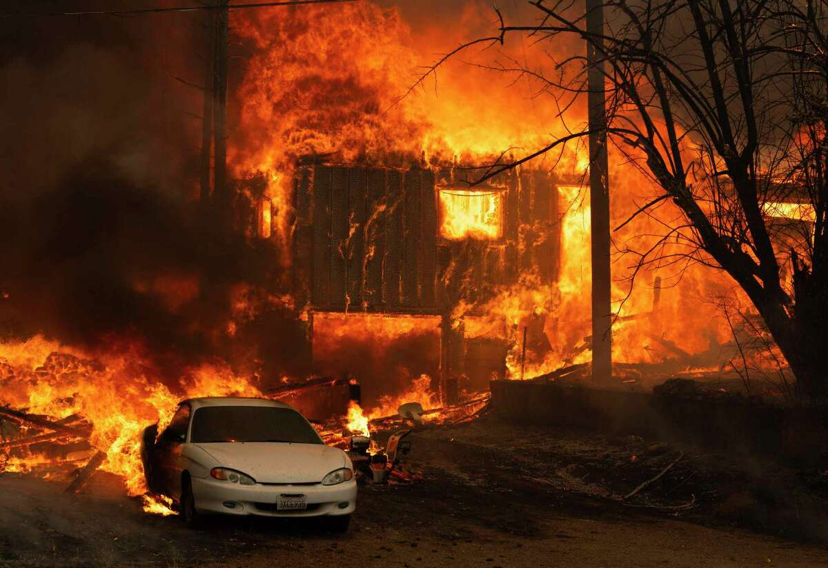 A home burns on Highway 89 south of Greenville, California, near Forgay Road during the Dixie fire on Aug. 5, 2021. (Nathaniel Levine/Sacramento Bee/TNS)