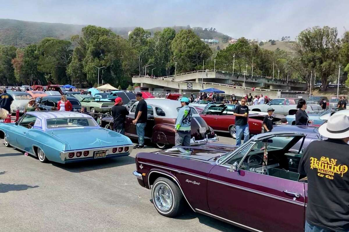 Competition cars make the scene at a low-rider show at Cow Palace in Daly City on Saturday, Aug. 14, 2021.