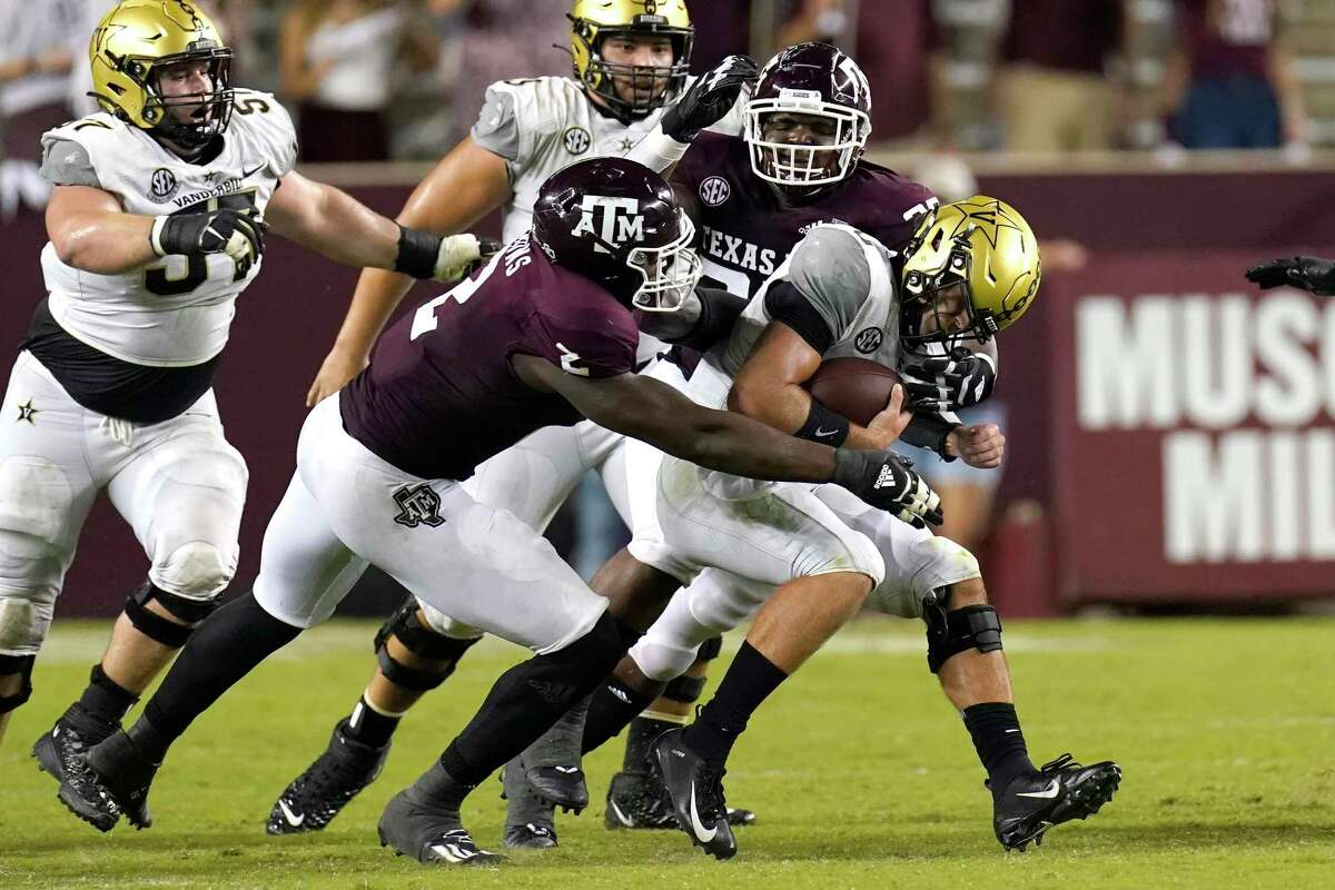 Texas A&M's Micheal Clemons (2) McKinnley Jackson during the second half of an NCAA college football game Saturday, Sept. 26, 2020, in College Station, Texas. Texas A&M won 17-12. (AP