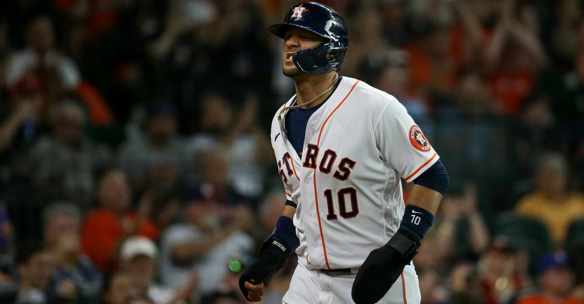 Houston Astros first baseman Yuli Gurriel (10) walks to the dugout after scoring off of a sacrifice fly hit by shortstop Carlos Correa (1) during the third inning of an MLB game against the Texas Rangers at Minute Maid Park on Saturday, July 24, 2021, in Houston.